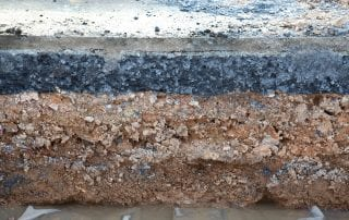 Layer soil beneath asphalt cement concrete
